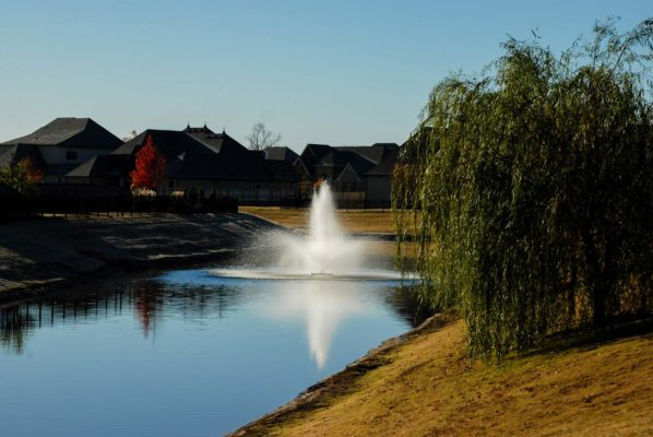Bixby's River's Edge neighborhood with pond and fountain.